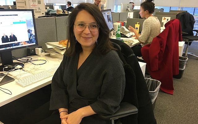 Bari Weiss, at what was then her desk, in The New York Times office in Midtown Manhattan. (Josefin Dolsten)