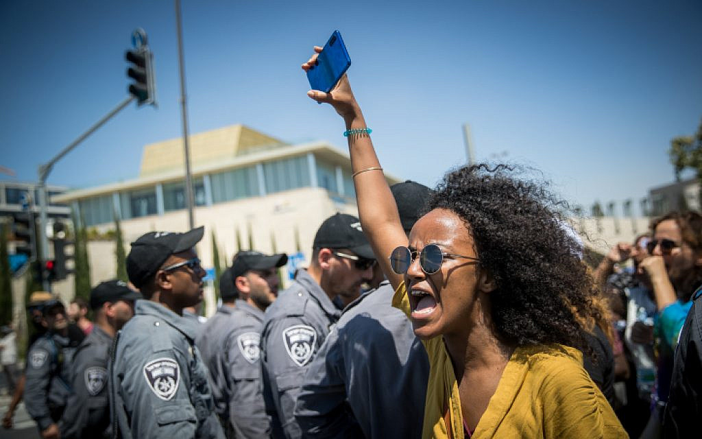 Ethiopians and supporters demonstrate against police violence and discrimination following the death of 19-year-old Ethiopian Israeli, Solomon Tekah, who was shot and killed in Kiryat Haim by an off-duty police officer, in Jerusalem, July 15, 2019. (Yonatan Sindel/Flash90)