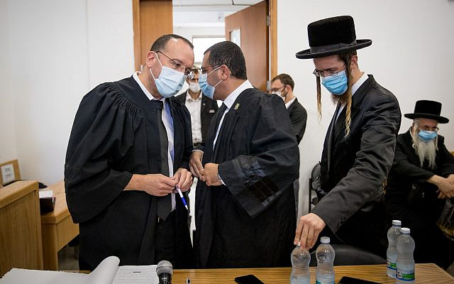 Family members of Malka Leifer, an Ultra orthodox teacher wanted in Australia for child sex abuse, arrive for a court hearing at the District Court in Jerusalem on July 20, 2020. Photo by Yonatan Sindel/Flash90