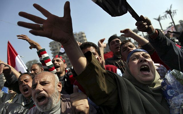 Egyptians protesters chant anti-Muslim Brotherhood slogans at a rally in Tahrir Square, in Cairo, Egypt, Friday, Nov. 30, 2012. (AP Photo/Khalil Hamra)