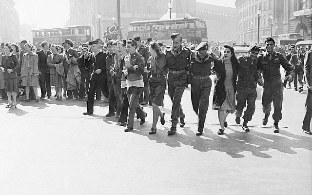 Civilians and service personnel in London celebrating V-J Day on August 15, 1945 (Wikipedia/ © IWM / © Crown Copyright: IWM via Jewish News)