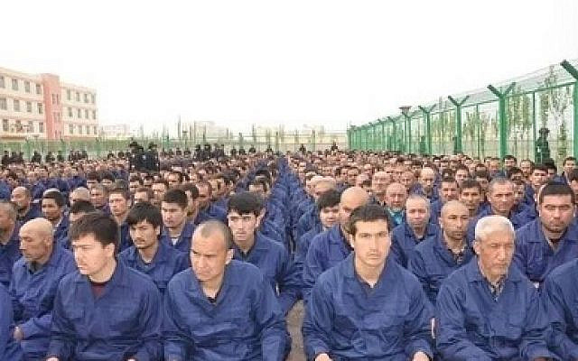 Detainees in a Xinjiang Re-education Camp listening to de-radicalization talks (credit: Wikimedia Commons)