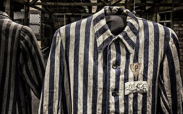 Shirt in Foreground Worn by a Political Prisoner in Auschwitz. Collection of the Auschwitz-Birkenau State Museum, Oświęcim, Poland. ©Musealia (Courtesy)