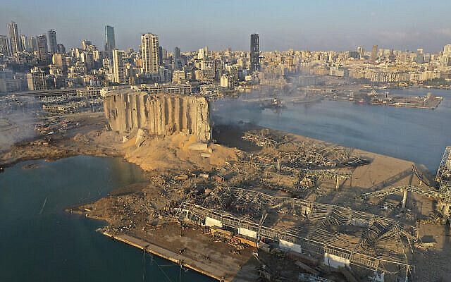 A drone picture shows the scene of an explosion that hit the seaport of Beirut, Lebanon, Wednesday, Aug. 5, 2020. A massive explosion rocked Beirut on Tuesday, flattening much of the city's port, damaging buildings across the capital and sending a giant mushroom cloud into the sky. (AP Photo/Hussein Malla)