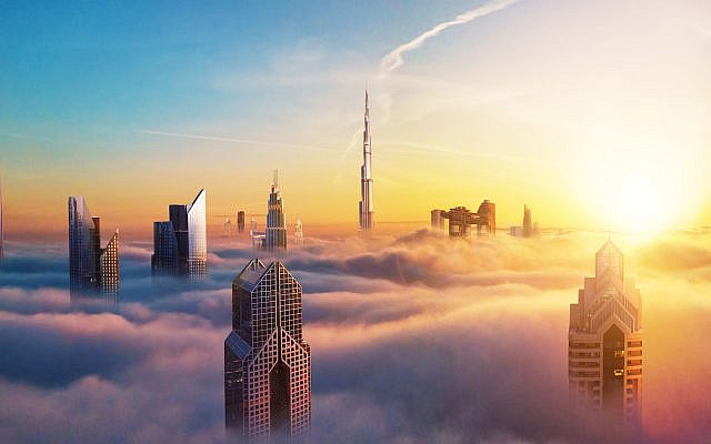 Downtown Dubai through the clouds at sunset (iStock)