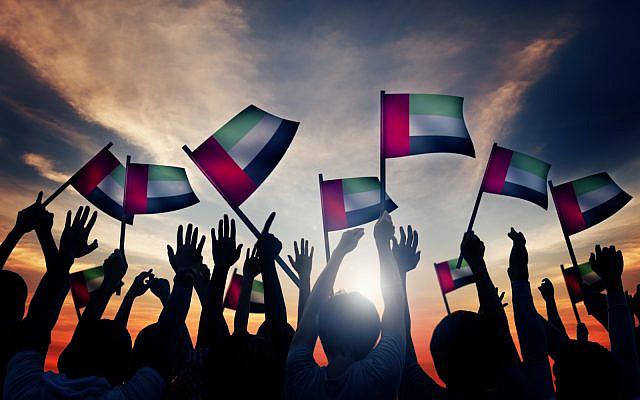 People waving flag of the United Arab Emirates (UAE). (iStock)