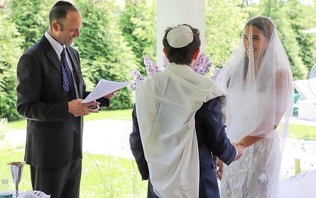 Victoria and Matt's beautiful wedding, officiated by Rabbi Eli Kohl. Photo credit: Megan Mills (copyright-free)