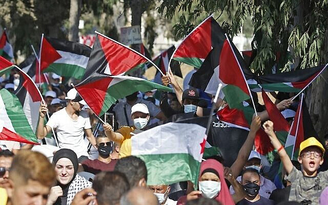 Palestinians protest against the United Arab Emirates' decision to normalise ties with Israel, in the village of Turmus Aya near Ramallah on August 19, 2020.  (Photo by JAAFAR ASHTIYEH / AFP) - From the Times of Israel website.