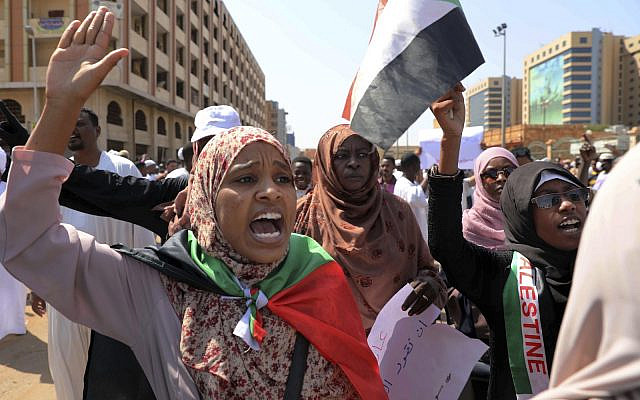 Women chant slogans to protest Sudanese President of the Sovereignty Council Abdel Fattah Abdelrahman Burhan's contentious decision to meet Prime Minister Benjamin Netanyahu in a move toward normalizing relations, in Khartoum, Sudan. Feb. 7, 2020. (AP Photo/Marwan Ali)