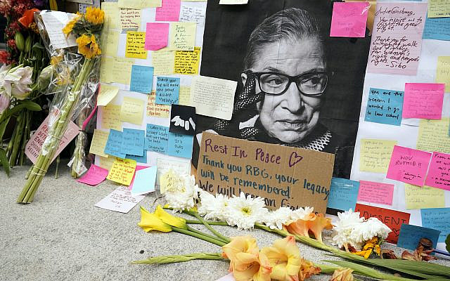 A memorial to US Supreme Court Justice Ruth Bader Ginsburg, outside the Harvard Law School library at Langdell Hall, on the campus of Harvard University, in Cambridge, Mass. Sept. 22, 2020 (AP Photo/Steven Senne)