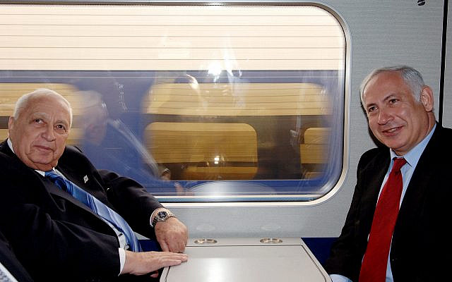 Ariel Sharon and Bibi Netanyahu, during the inauguration of the railroad line from Ashkelon to Jerusalem. (Credit BICOM via Jewish News)