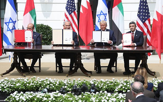 Dr. Abdullatif bin Rashid Al Zayani, Minister of Foreign Affairs for the Kingdom of Bahrain, Benjamin Netanyahu, Prime Minister of the State of Israel, U.S. President Donald J. Trump and Abdullah bin Zayed Al Nahyan, Minister of Foreign Affairs and International Cooperation of the United Arab Emirates sign papers during the Abraham Accords Signing Ceremony at The White House on September 15, 2020, in Washington, DC. (Oliver Contreras/SIPA USA via Jewish News)