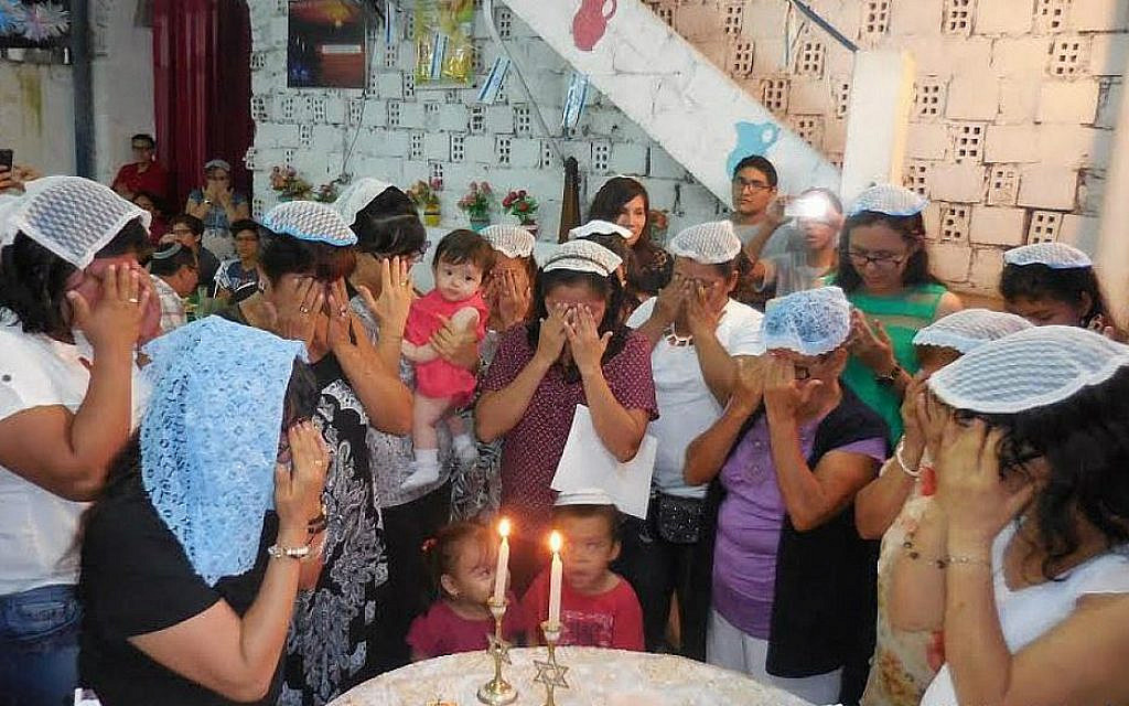 Lighting Holiday Candles in Iquitos