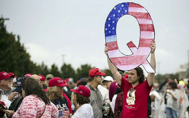 David Reinert, a QAnon founder, holding a Q sign waits in line with others to enter a campaign rally with President Donald Trump and Republican US Senate candidate Rep. Lou Barletta, R-Pa., August 2, 2018, in Wilkes-Barre, Pennsylvania (AP Photo/ Matt Rourke)