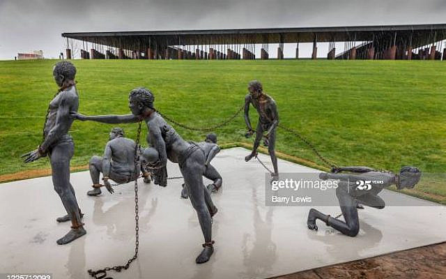 Kwame Akoto-Bamfo's 'Nkyinkim' sculpture, dedicated to the memory of the victims of the Transatlantic slave trade at the entrance of the National Memorial for Peace And Justice on 3rd March 2020 in Montgomery, Alabama, United States. It has the title Nkyinkyim meaning twisted, relating to the proverb 'lifes journey is twisted.  it was created at the artists studio in Ghana and installed in Montgomery for the opening of the Memorial in 2018. Informally known as the National Lynching Memorial, a national memorial to commemorate the victims of lynching in the United States was the brainchild of Bryan Stevenson, who was inspired by the Holocaust memorials in Europe and by the post-Apartheid Truth and Reconciliation process in South Africa. The Memorial in Montgomery was opened in 2018. Current research shows that 4,084 African Americans were lynched between 1877 and 1950. More than 85% of the lynchings took place in the Southern states.e wider process of acknowledgement and healing they want to achieve.(photo by Barry Lewis/InPictures via Getty Images)