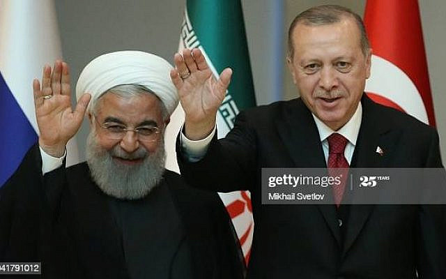 ANKARA, TURKEY - APRIL 4:  (RUSSIA OUT)   Turkish President Recep Tayyip Erdogan (C) and Iranian President Hassan Rouhani (L) pose for a photo during their meeting at the presidential palace on April 4, 2018 in Ankara, Turkey.  Russian President Vladimir Putin is having a two-days state visit to Turkey. (Photo by Mikhail Svetlov/Getty Images)
