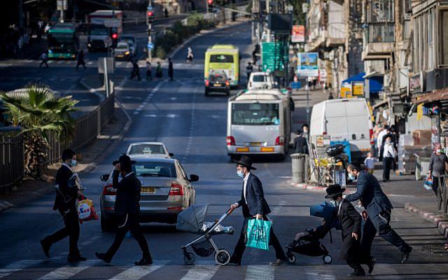Ultra-Orthodox Jews walk in Jerusalem, on October 19, 2020. (Yonatan Sindel/Flash90)