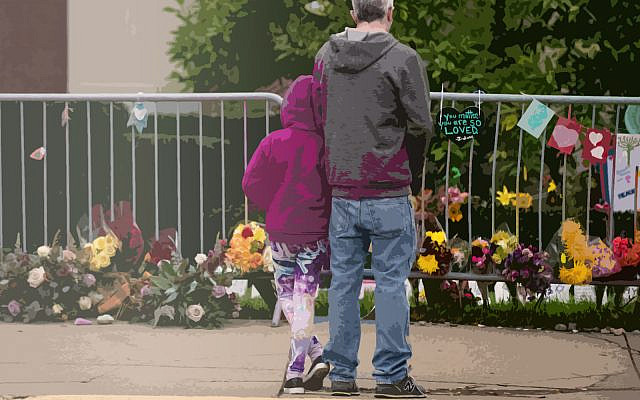 Visitors look at items well-wishers have left behind along the fence at the Tree of Life Synagogue on the 1st Anniversary of the attack on October 27, 2019 in Pittsburgh, Pennsylvania. (Jeff Swensen/Getty Images)
