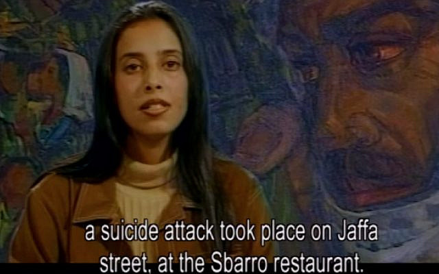 Ahlam Tamimi reads the news of the Sbarro bombing she had orchestrated hours earlier on Istiqlal TV, August 9, 2001. (Screenshot)