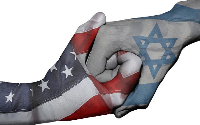 Flags of United States and Israel overprinted on two hands. (iStock)