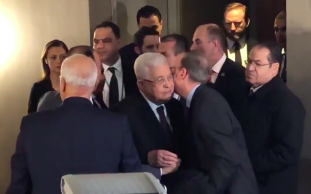 J Street CEO Jeremy Ben-Ami kisses Palestinian Authority President Mahmoud Abbas during a 2019 meeting in NYC.   Credit: Screenshot