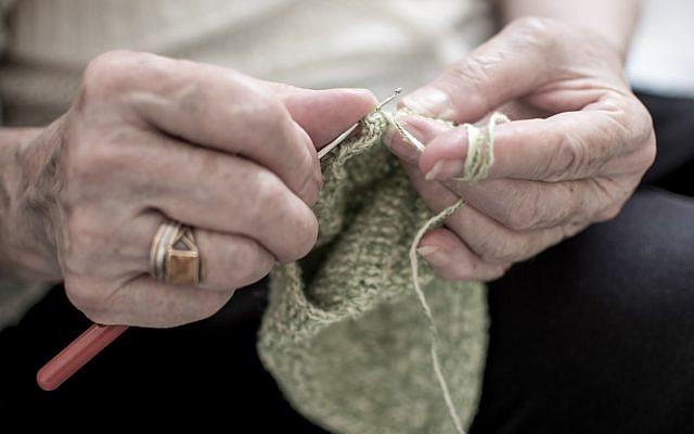 Hands knitting. (iStock)
