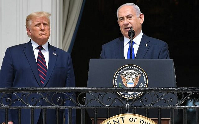 US President Donald Trump watches as Prime Minister Benjamin Netanyahu speaks from the Truman Balcony at the White House during the signing ceremony of the Abraham Accords where the countries of Bahrain and the United Arab Emirates recognize Israel, on the South Lawn of the White House in Washington, DC, September 15, 2020. (Photo by SAUL LOEB / AFP)