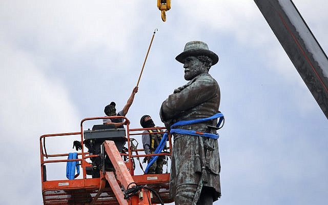 ILLUSTRATIVE: In this Friday, May 19, 2017, file photo, workers prepare to take down the statue of former Confederate Gen. Robert E. Lee, which stands over 100 feet tall, in Lee Circle in New Orleans. (AP Photo/Gerald Herbert, File)