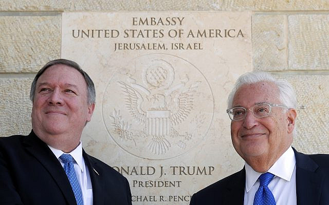 US Secretary of State Mike Pompeo, left, and US ambassador to Israel David Friedman stand next to the dedication plaque at the US Embassy in Jerusalem on March 21, 2019. (Jim Young/Pool/AFP)