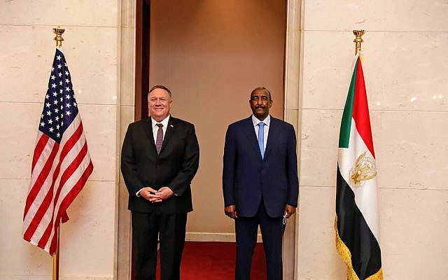US Secretary of State Mike Pompeo stands with Sudanese Gen. Abdel-Fattah Burhan, the head of the ruling sovereign council, in Khartoum, Sudan, Tuesday, Aug. 25, 2020. (Sudanese Cabinet via AP)