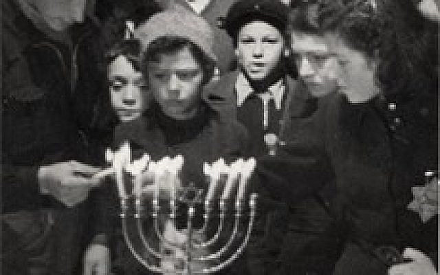 Hanukkah candle lighting ceremony in the Westerbork Transit Camp, Netherlands, 1943. (From Yad Vashem Archives)