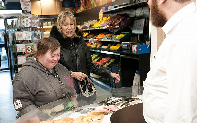 Debbie who is supported by Kisharon, shopping. The picture was taken pre-coronavirus pandemic.