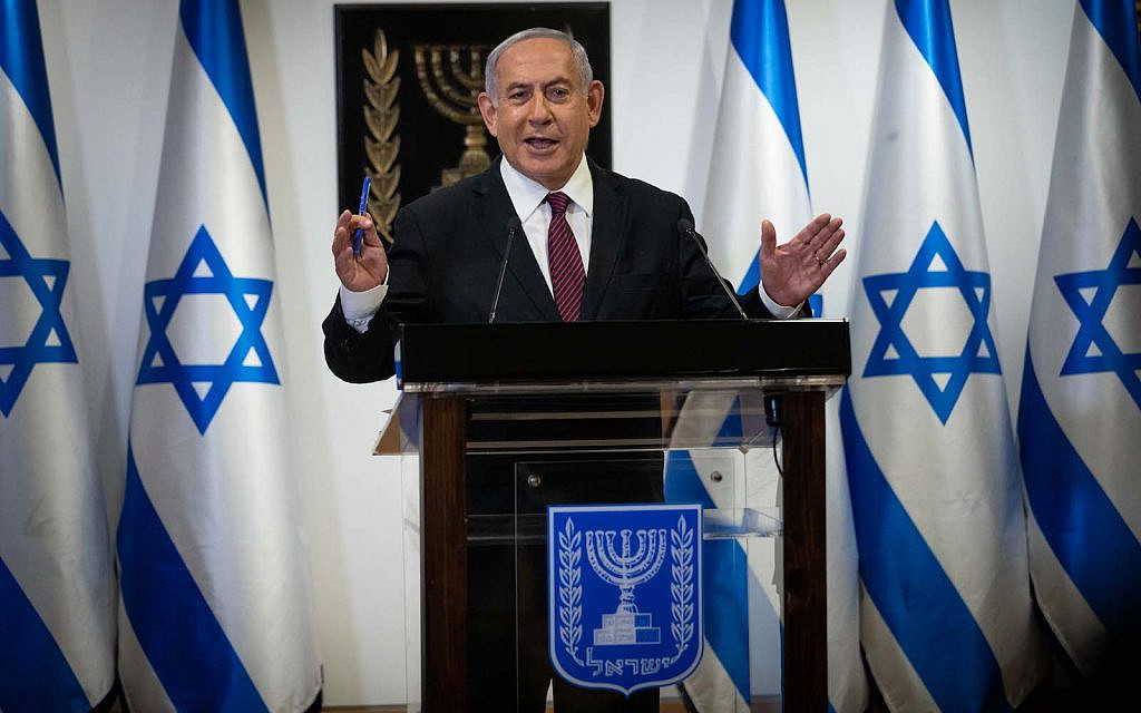 Prime Minister Benjamin Netanyahu gives a statement to the media in the Knesset in Jerusalem, December 22, 2020. (Yonatan Sindel/Flash90)