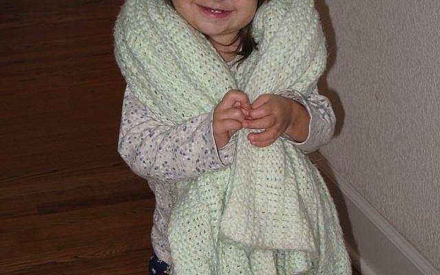 A friend enjoying her knitted blanket