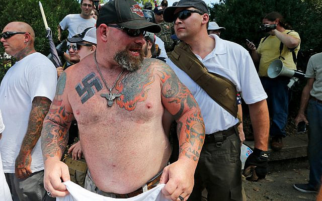 A white supremacist leaves Emancipation Park in Charlottesville, Virginia, August 12, 2017. (AP Photo/Steve Helber)