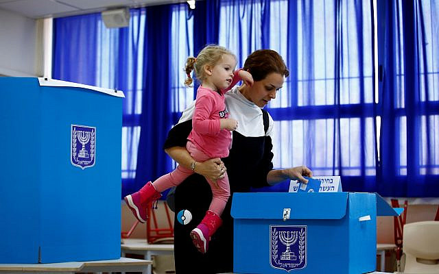 A woman casts her ballot as she votes in Israel's national election at a polling station in Tel Aviv, Israel, March 2, 2020. (REUTERS/ Corinna Kern, used with permission)