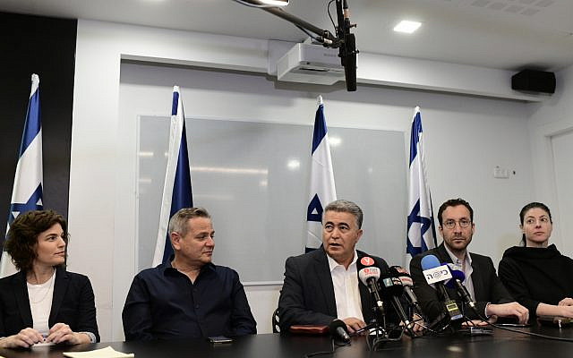 Chairman of the Labor party Amir Peretz (C), Meretz leader Nitzan Horowitz (2L) and party members hold a press conference in Tel Aviv on March 12, 2020. (Tomer Neuberg/ Flash90)