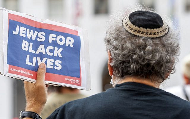A man wearing a kippah holds a sign reading 'Jews for Black Lives' at the weekly Black Lives Matter 'Jackie Lacey Must Go!' protest in front of the Hall of Justice in Los Angeles, California, September 9, 2020. (VALERIE MACON / AFP)