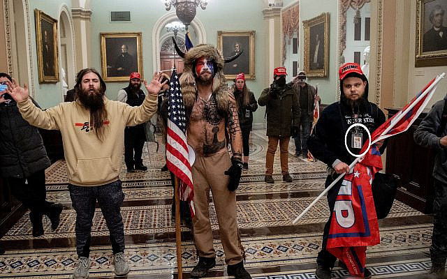 Supporters of US President Donald Trump, including Jake Angeli (C), a QAnon supporter, enter the Capitol in Washington, DC on Januart 6, 2021.(Saul LOEB / AFP)