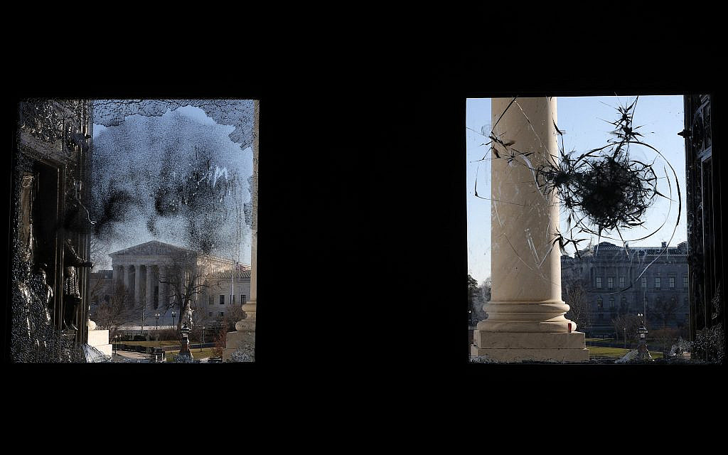 The US Supreme Courtת seen through a damaged entrance of the Capitol, January 7, 2021. (Alex Wong/Getty Images)
