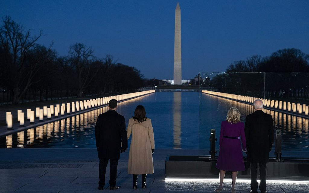 President-elect Joe Biden and his wife Jill Biden are joined by Vice President-elect Kamala Harris and her husband Doug Emhoff to participate in a COVID-19 memorial event at the Lincoln Memorial Reflecting Pool, Tuesday, Jan. 19, 2021, in Washington. (AP Photo/Evan Vucci)