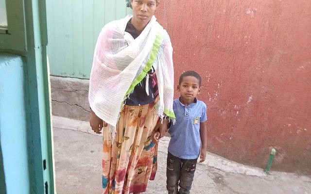 Biniyam with his mother in Ethiopia before his rescue