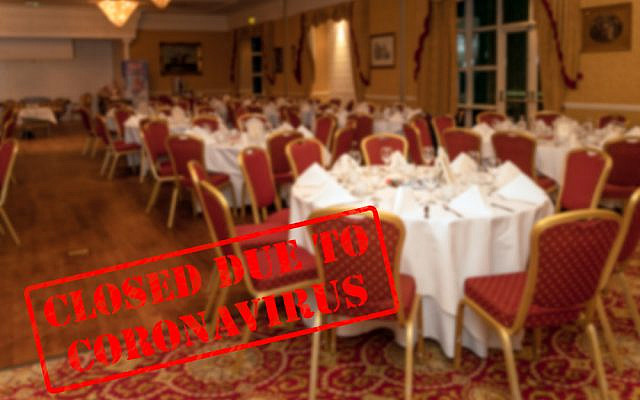 Defocused, blurred view of interior of an upmarket wedding venue or restaurant, empty and closed due to coronavirus or covid 19 pandemics