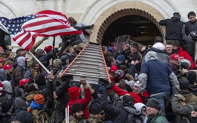 January 6, 2021, Washington Dc, District of Columbia, United States: Rioters clash with police using big ladder trying to enter Capitol building through the front doors. Rioters broke windows and breached the Capitol building in an attempt to overthrow the results of the 2020 election. Police used buttons and tear gas grenades to eventually disperse the crowd. Rioters used metal bars and tear gas as well against the police. (Credit Image: © Lev Radin/Pacific Press via ZUMA Wire) Via Jewish News