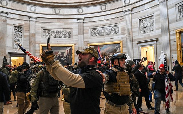 Time for a selfie? Supporters of US President Donald Trump enter the US Capitol's Rotunda on January 6, 2021, in Washington, DC. (Saul Loeb/AFP)