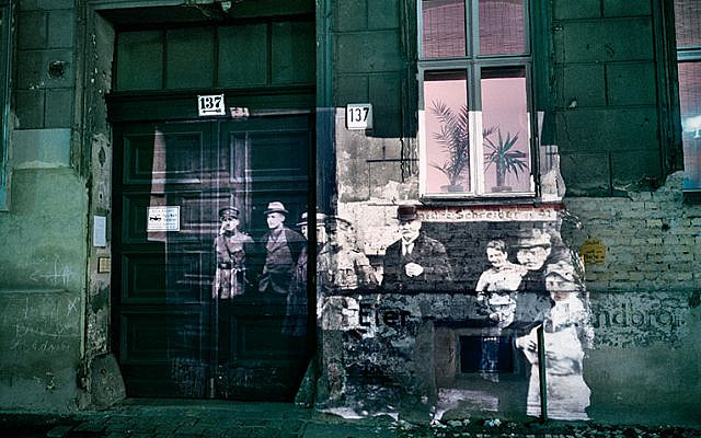 Linienstrasse 137: Slide projection of police raid on former Jewish residents, 1920, Berlin, 1992, color photograph and on-location installation by Shimon Attie (Courtesy of Shimon Attie)