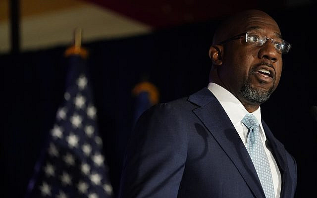 Raphael Warnock, a Democratic candidate for the US Senate speaks during a rally, November 3, 2020, in Atlanta. (AP Photo/ Brynn Anderson, Pool)
