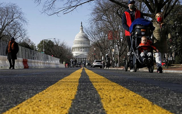 People try to see the Capitol as streets are blocked for security reasons ahead of U.S. President-elect Joe Biden's inauguration, in Washington, U.S., January 16, 2021. REUTERS/Eduardo Munoz     TPX IMAGES OF THE DAY
