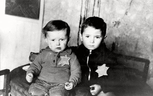 Two children wearing the Jewish badge in the Kovno Ghetto in February 1944.