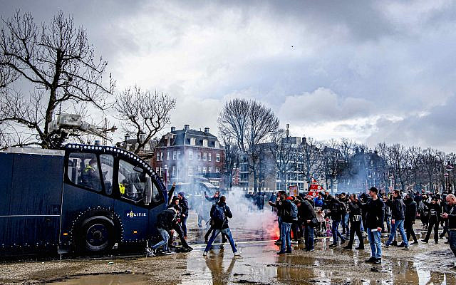 Hundreds of protestors not wearing face masks clash with Dutch riot police at an illegal protest against the Netherlands' new lockdown measures in Museumplein on January 17, 2021 in Amsterdam, Netherlands. Photo by Robin Utrecht/ABACAPRESS.COMNo Use Germany. No Use Netherlands.